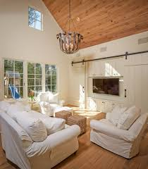 better built barns for a traditional family room with a stool and