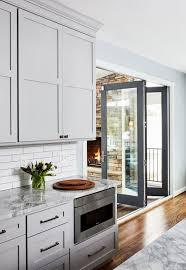 light grey kitchen cabinets transitional light grey kitchen with grey island
