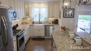 top 5 kitchen countertop choices for white cabinets for another great look consider going with giallo napole which is a consistent off white granite with light gold highlights and dark burgundy flecks