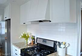 remodelaholic diy plank ceiling in a beautiful white kitchen