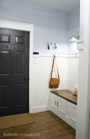 our mudroom makeover from dark to bright and light from black door white trim blue walls in mudroom