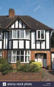 tudor style house uk england surrey semi detached house in mock tudor style stock