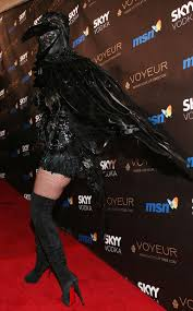 black and purple halloween background heidi klum drops a huge hint about this year u0027s halloween costume