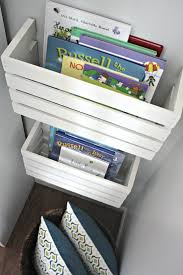 cut wooden crates in half to use as book magazine storage against