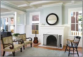 paint colors for living room with red brick fireplace painting