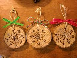 wood burned snowflake ornaments by ruffledandrustic