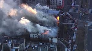 4 injured in large fire atop 6 story apartment building nation