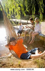 happy family sitting in hammock stock photo royalty free image