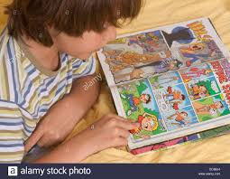 kid kids boy child children learning to read reading comic book