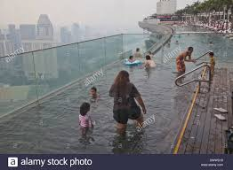 guests relax at the infinity pool at the famous marina bay sands