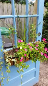Canopy Trash Can by Diy Trash Can Enclosure Repurposed Door Hide Outdoor Trash Cans