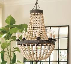wood bead ceiling light regina andrew scalloped wood bead chandelier copycatchic