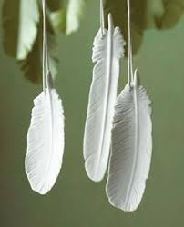 beautiful fresh white ceramic feathers with which to decorate