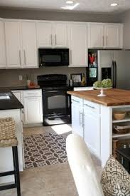 Smart Strategies For Kitchen Remodeling Subway Backsplash - White kitchen cabinets with butcher block countertops