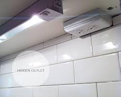 hidden outlets under the cabinets instead of breaking up the
