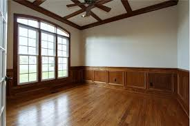 stained wainscoting in dining rooms door entry from foyer