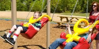handicap swing inclusive handicap accessible playground equipment bliss