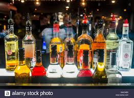 alcoholic drinks bottles bottles of alcoholic spirits in bar london uk stock photo