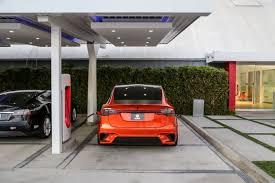 Tesla Carbon Fiber Interior Sema Bound Tesla Model X Goes From Family Suv To Carbon Fiber