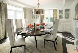 espresso oval dining table with white leather wingback dining