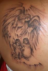 grey ink baby angels in mother shadow tattoo on back