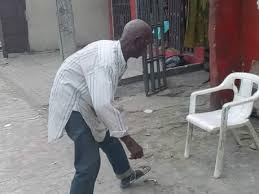 Bench Updater Elderly Man Partially Blocks Elekahia Road In Port Harcourt