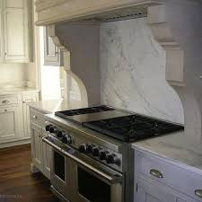Calcutta Marble Slab Backsplash Design Ideas - Marble backsplashes