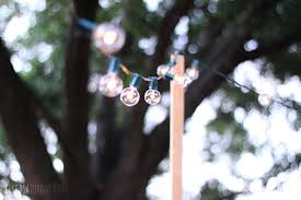 how to hang patio string lights like a saturday with use on