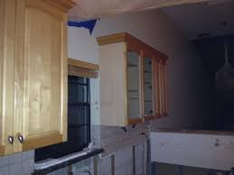 new upper kitchen cabinet boxes being installed code red