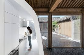 this mind blowing home u0027s undulating courtyard lifts up to form