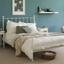 cream metal bed frame like the wall color too cozy home