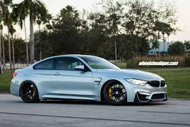 super lowered cars bmw m4 tries on matte black wheels on a lowered body