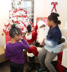 acs office of advocacy hosts holiday party for families