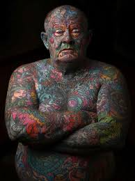 gangster covers every single inch of his in tattoos others