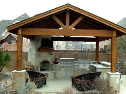 interesting outdoor kitchen with fireplace features stone