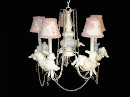 Pink Nursery Chandelier Casual White Wooden Shelves And White Wooden Baby Crib With Pink