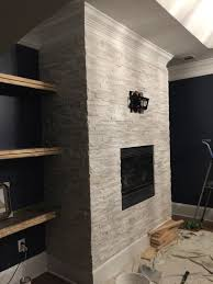 tiling a stacked stone fireplace surround bower power