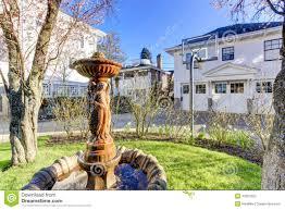 beautiful fountain statue in backyard garden stock photo image