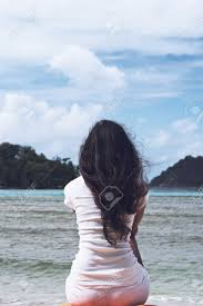 black hair for the beach close up slim woman with long wavy black hair sitting on the