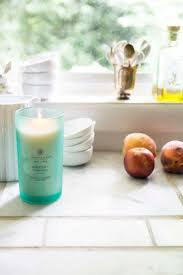 45 best wellness candles images on pinterest wellness chesapeake bay candle in the kitchen with white dishware and peaches on thou swell thouswellblog