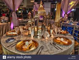 elaborate table setting decorated with fancy napkins candles and