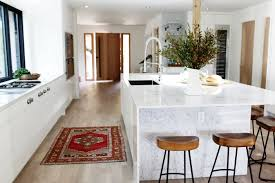 scandi in seattle a midcentury makeover with lots of affordable kitchen with marble island with waterfall counter in a remodeled ralph anderson 1966 home in bellevue