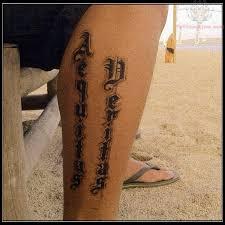 exotic aequitas veritas lower leg tattoo design idea for men