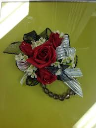 Red Rose Wrist Corsage Red Roses In A Wrist Corsage With Wax Flower And White Ribbon