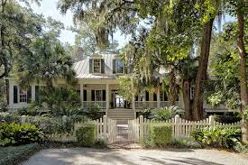 lowcountry architecture exterior tropical with metal roof wicker