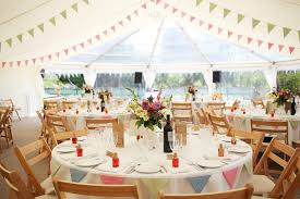 lovely country style wedding marquee with clear roof jugs of