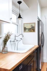 what color paint goes with white kitchen cabinets our favorite white paint color for kitchens cabinets the