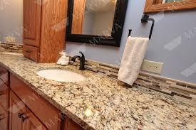 granite cecilia santa cecilia granite white cabinet backsplash