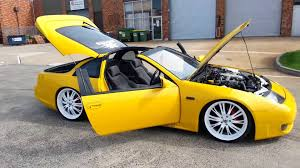 yellow nissan 300zx with 20inch white rims lowered bodykits custom