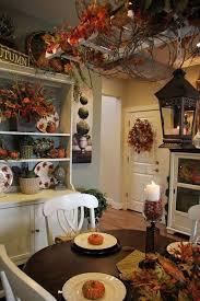 Fall Kitchen Decor - cozy kitchen table white finger